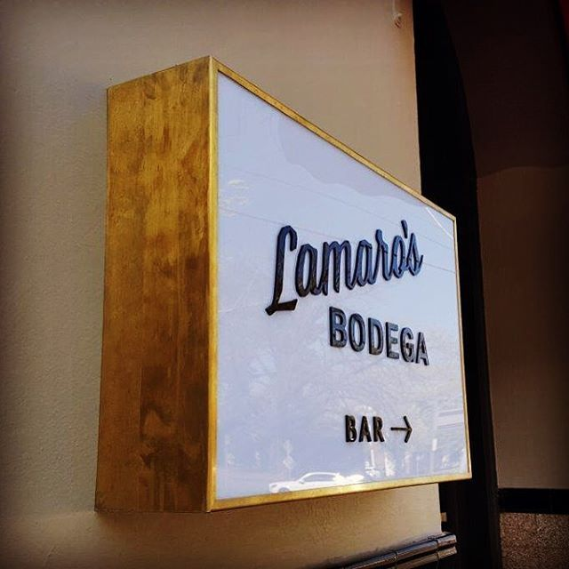 Illuminated light box with brass frame for Lamaros Bodega by Sign Industries…