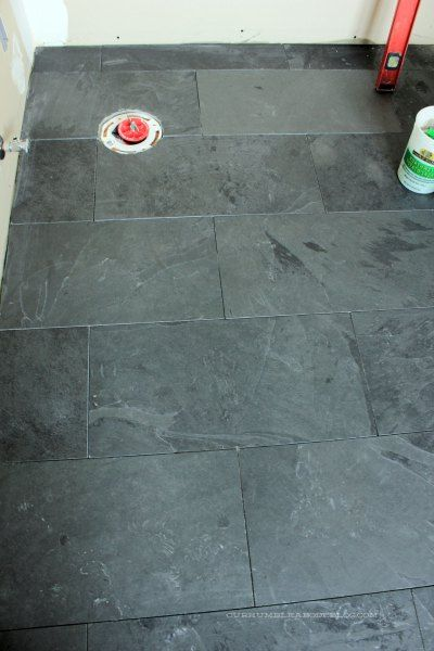 12 by 24 Montauk Black slate tiles in staggered brick pattern for bathroom floor.  Tiles from Home Depot