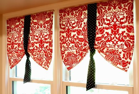 Kind of a fun window treatment and a way to get a pop of color in the kitchen. Kind of reminds me of carnival flags or something.