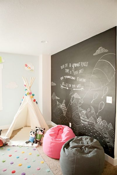 This is such a lovely idea for a child's playroom, the chalk board is perfect to encourage creative doodles without ruining your walls!