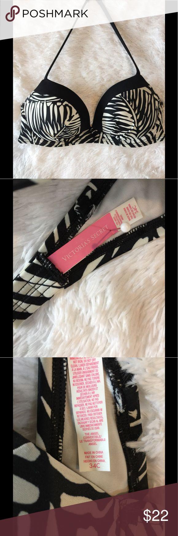 Victoria's Secret Zebra Bikini Top Black & white Victoria's Secret bikini top.  Size 34C , in like new condition, no flaws no pets/smoke closet Victoria's Secret Swim Bikinis