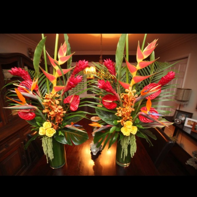 Wedding centerpieces with tropical flowers                              …