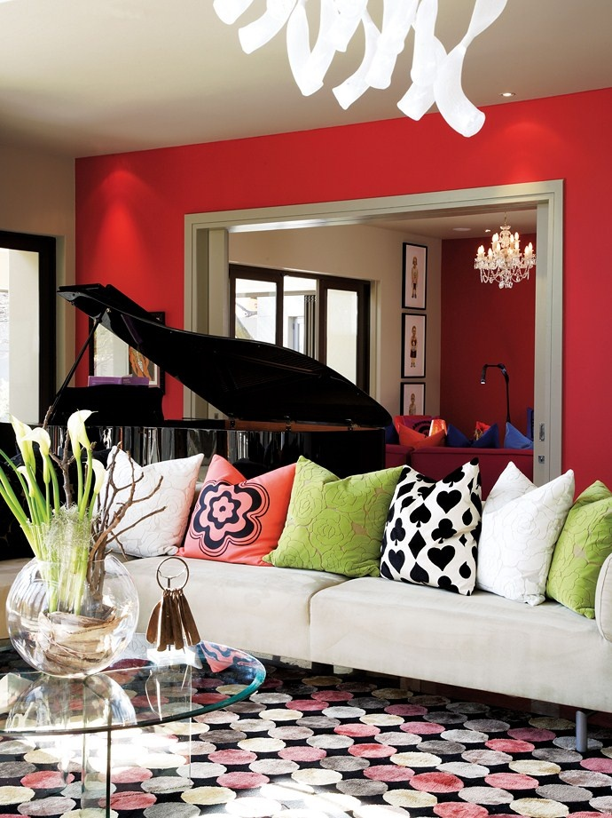 a great way to use red on a wall border it with a lot of white to relieve the heaviness