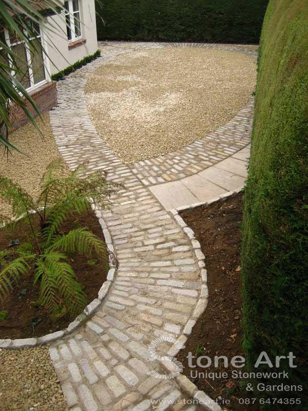 Cobble path by Stone Art Unique Stonework & Gardens - love the combination of stone, gravel, and mulch