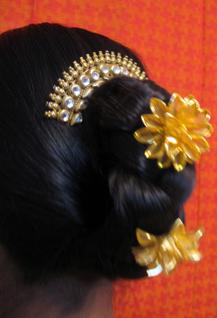 This is a traditionally hairstyle, usually in ancient times. Maharashtrian Ladies use to tie up their hair in this manner, it also known as the Khopa