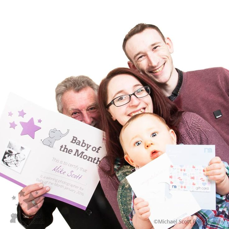 January Baby of the Month winner, Alex, collecting his prize of a £100 Mothercare Voucher from Mike Scott Photography