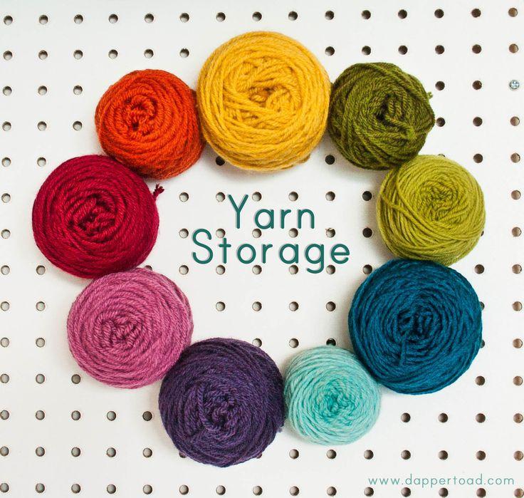 Yarn Storage (peg board with skeins of yarn stuck to them!!)