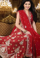 This red faux chiffon lehenga style saree is uniquely crafted with zari, sequins, stone and beads work in form of floral motif. Matching blouse comes along with this and it can be customized upto 38 inches. Slight variation in colour is possible.
