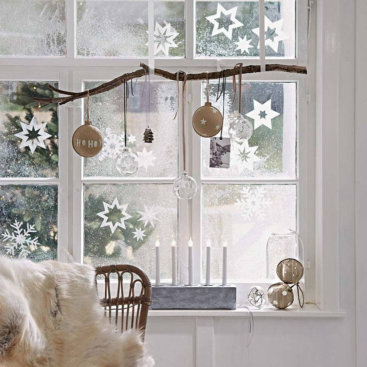 hang a branch in the window with wide ribbon and hang ornaments