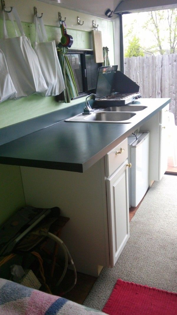 Woman converts cargo trailer to stealth micro camper for Trailer kitchen ideas