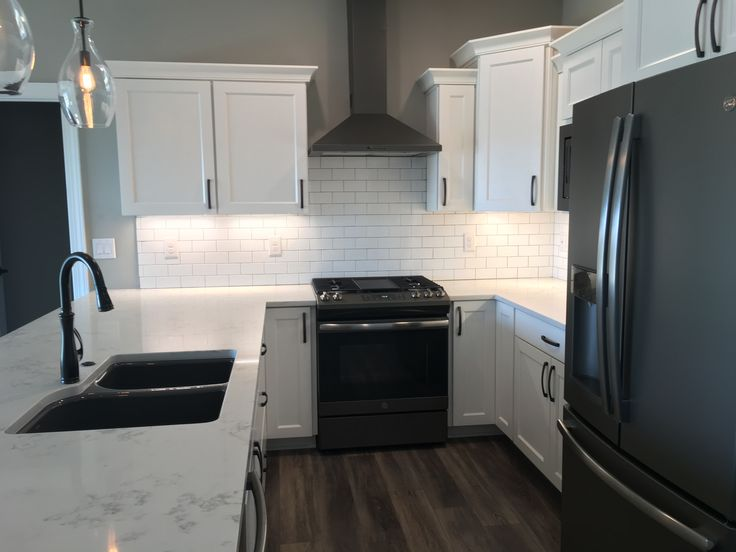 White Kitchen Cabinets Black Hardware Marble Look Quartz