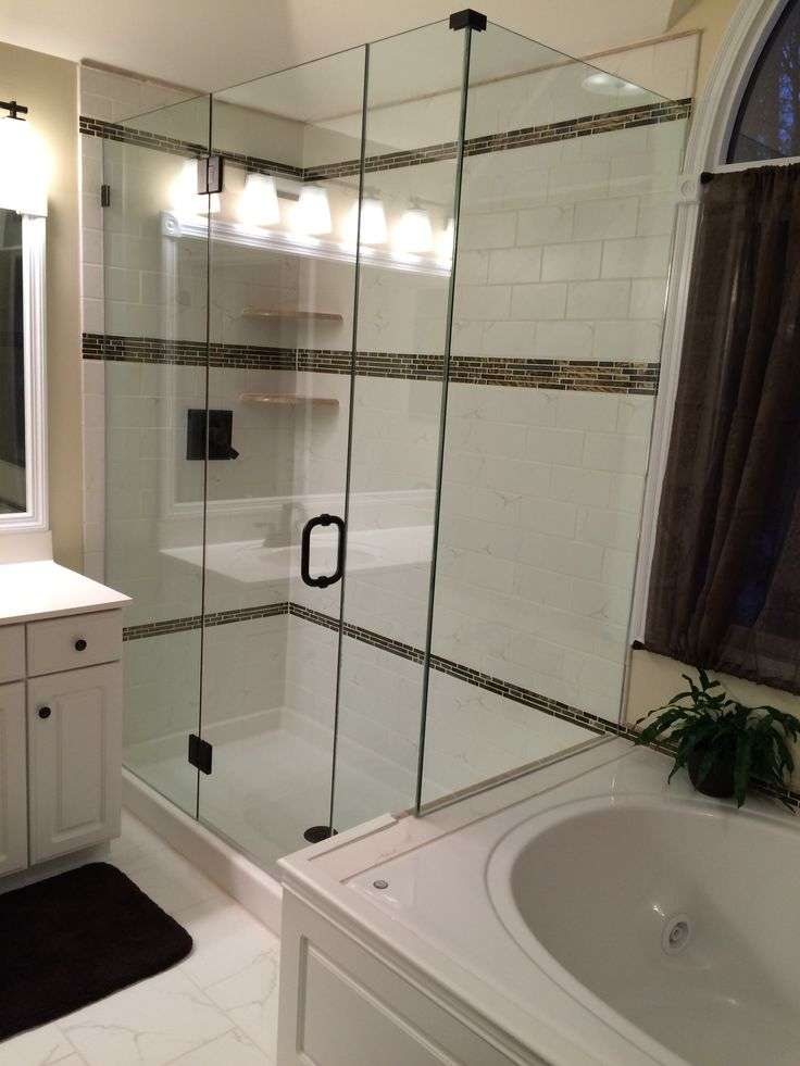 totally frameless shower enclosure glass to glass hinging to get around the vanity