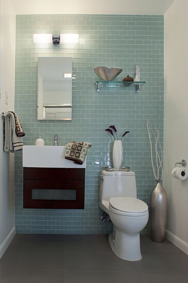 modern guest bathroom with blue subway ceramic wall white concrete walls ronbow vanity two piece tilet frameless mirror wall mounted glass shelf grey - Guest Bathroom Design