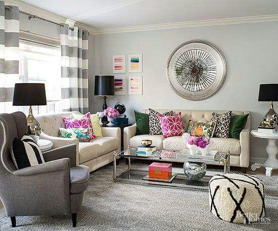 A Neutral Color Scheme Gives This Living Room A Larger Than Life Feel. It  Also Allows For A Mix Of Bold Patterns And Colorful Decorations. Part 94