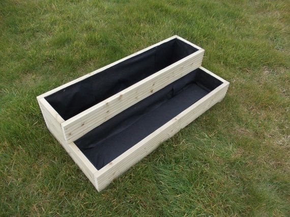 Wooden Step Planter  Made from first quality pressure treated, tanalised timber All screwed together, comes fully assembled and with drainage holes Fully lined   Available in 4 standard sizes: 48 x 18 x 11 40 x 18 x 11 31 x 18 x 11 24 x 18 x 11  Can be made to your measurements :-) Please do not hestitate ask any questions   Please Visit our shop Wooden Paradise to see more similar items