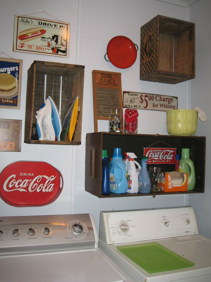Old crates and vintage metal signs (Coca-Cola, etc...) used to decorate and store cleaning supplies for my laundry room!