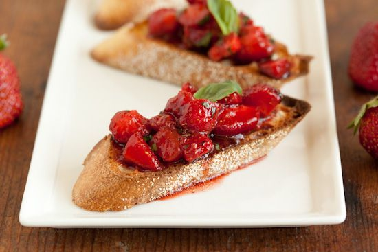 Strawberry Bruschetta: 1 pint strawberries, hulled and chopped 1 tablespoon balsamic vinegar 1 tablespoon extra virgin olive oil 1 tablespoon minced fresh basil pinch of salt freshly ground black pepper, to taste pinch of crushed red pepper (optional) 1 baguette of French- or Italian-style bread, cut into 1/2-inch slices extra basil for garnish (optional)