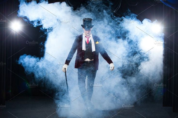 Magician, Juggler man, Funny person, Black magic, Illusion standing on the stage with a cane of beautiful light. shrouded in a beautiful mysterious smoke by mif on @creativemarket