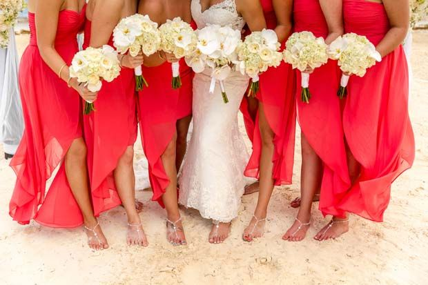 Bride and bridesmaids wearing long sizzling coral dresses / beach wedding / Aldabella Photography