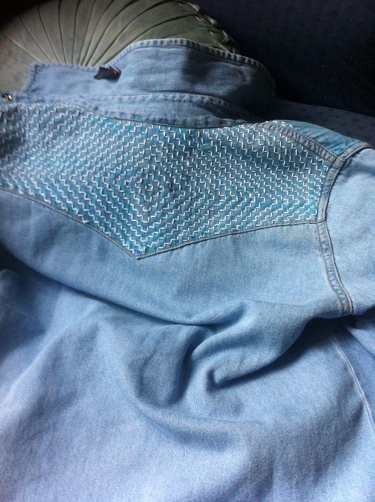 Denim shirt yoke detail, sashiko stitching, mountain form