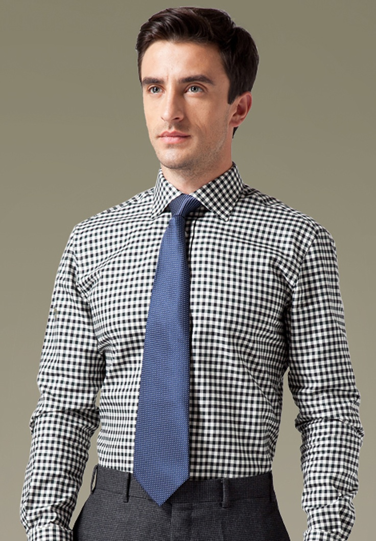 This formal black & navy blue check shirt projects a young ...