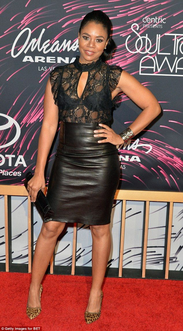 Leather and lace: Actress Regina hall also went with a black number, opting for a leather, high-waist knee-length skirt paired with a sexy sheer top that showed off her black bra and ample cleavage
