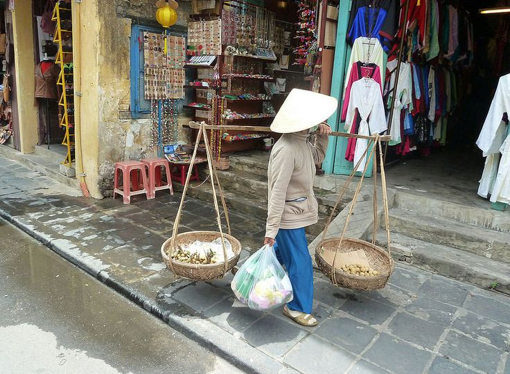 The fruit basket ladies of Vietnam sell produce in the streets balanced on their shoulders.