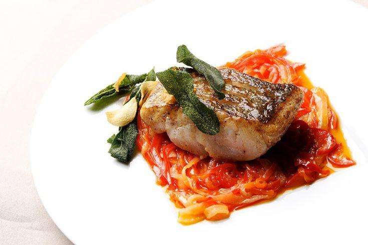 Pascal Aussignac's pan-fried hake recipe comes with a red pepper relish that perfectly matches this simple to make but impressive hake recipe.