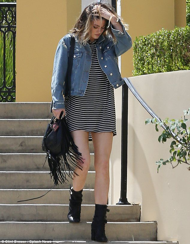 Kylie Jenner sported a simple striped black and white dress and denim jacket in Calabasas www.redreidinghood.com