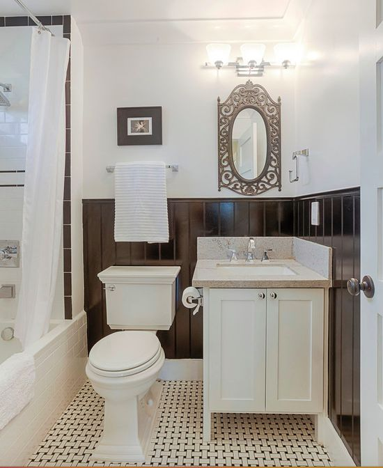 New construction craftsman for Ocean Development in Wilshire Center, Los Angeles, featuring a beautiful traditional craftsman bathroom with unique dark wood wall paneling, marble sink and craftsman toilet.  Design, Construction and Staging by Carley Montgomery. Photo by Eric Charles.