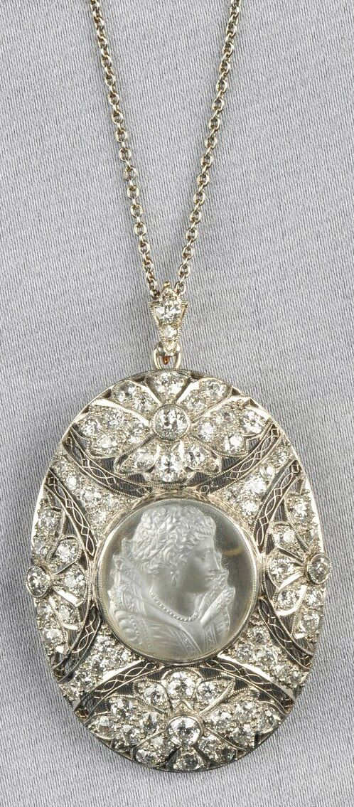 Platinum Moonstone Cameo, and Diamond Pendant/Brooch, set with a moonstone cameo carved to depict an elaborately dressed Elizabethan maiden, further set with old European-cut diamonds,