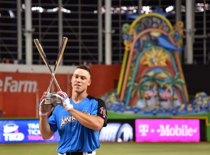 2017 MLB Home Run Derby  -  July 10, 2017:     Aaron Judge celebrates with the trophy after winning the 2017 MLB Home Run Derby. - Steve Mitchell, USA TODAY Sports