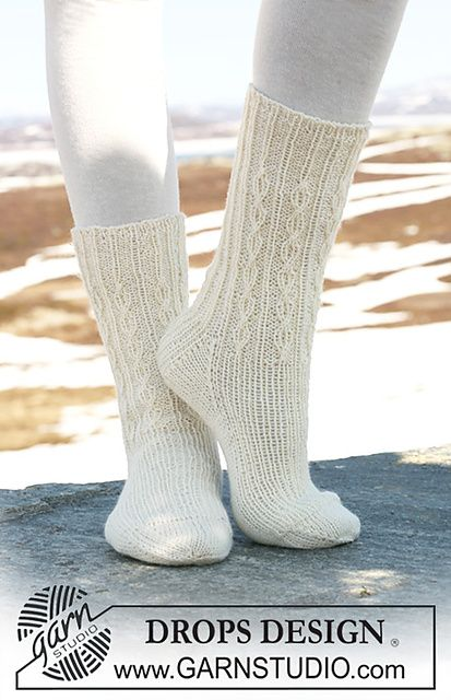 "Ravelry: 116-40 Socks in ""Fabel"" with rib and simple cables pattern by DROPS design"