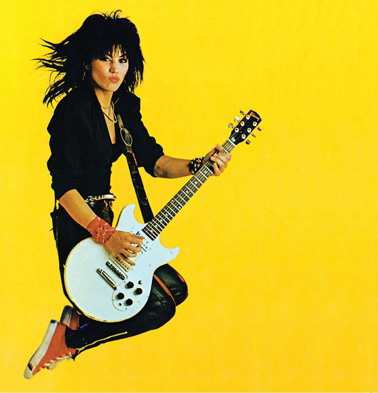 This is one of many favorite photographs since I first saw it... Love the expression on her face, the bright yellow background, caught in mid-air... It captures her pure passion for rock n roll. She now has the honor of being in the Rock and Roll Hall of Fame. fp