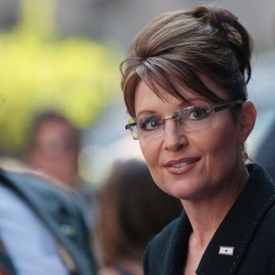 Here is a photo of Sarah Palin with her finished updo, where you can see how to style the fringe.