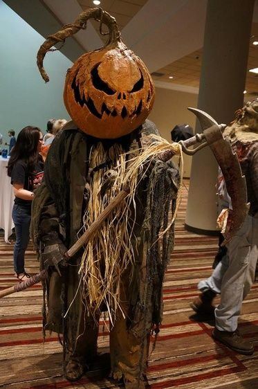 I need to get caught up on this thread - so many amazing costumes!!! Here's mine from this past weekend at MHC. I normally use the pumpkin head and cloak as my scarecrow in the haunt but when I made the pumpkin I made sure to make the opening in the bottom big enough to fit my head so it could be worn some day. I had a great time at the costume ball.