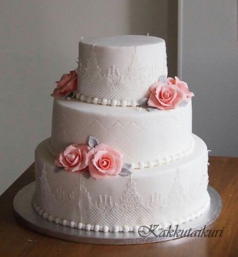 Lace wedding cake with silver leaves and nude roses