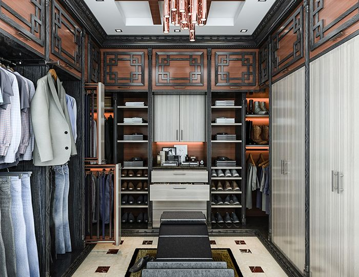 This Asian Influence Master Closet Organizer Features Open Hanging For Casual Wear And Doors Over Business