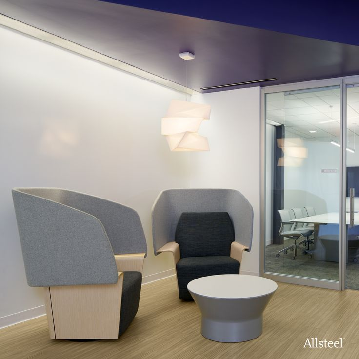 Space-defining seating and moveable glass walls offer private gather spaces for workers, without the feeling of being physically separated from the group.   #Interiors #WorkplaceDesign