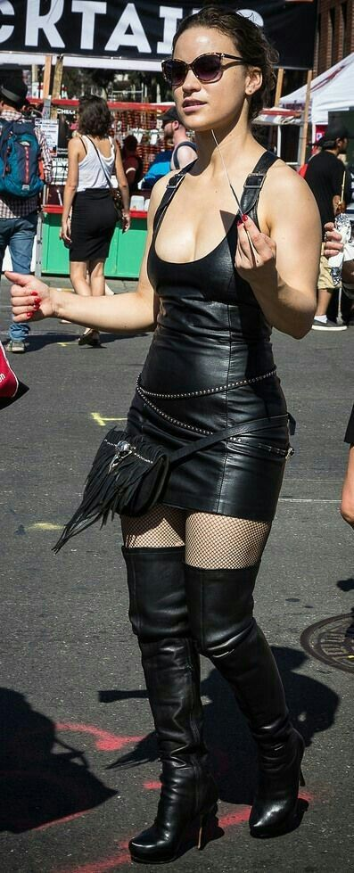 Candid Amateur Street Style Black Leather Tank Minidress And Thigh Boots