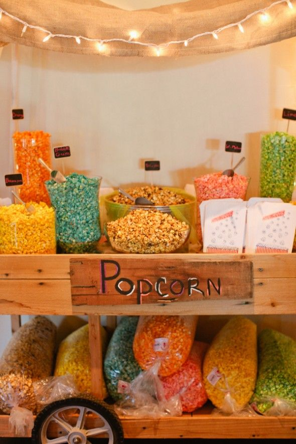 A popcorn bar at a camp-themed wedding. Too cute. This could also be good for a backyard party in the summertime!
