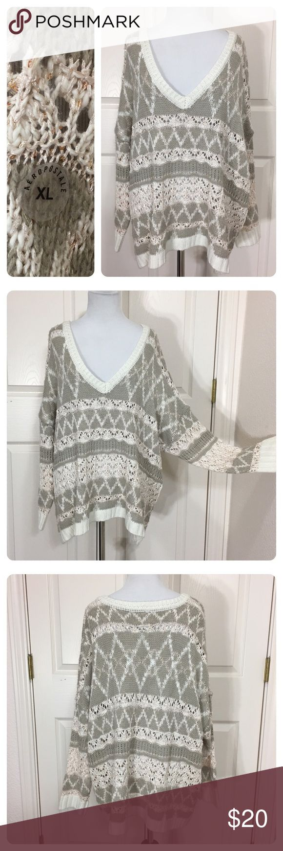 NWOT! Aeropostale open weave sweater New without tags. Size sticker still on. Pretty open weave cream, taupe with a little metallic threading throughout. Aeropostale Sweaters
