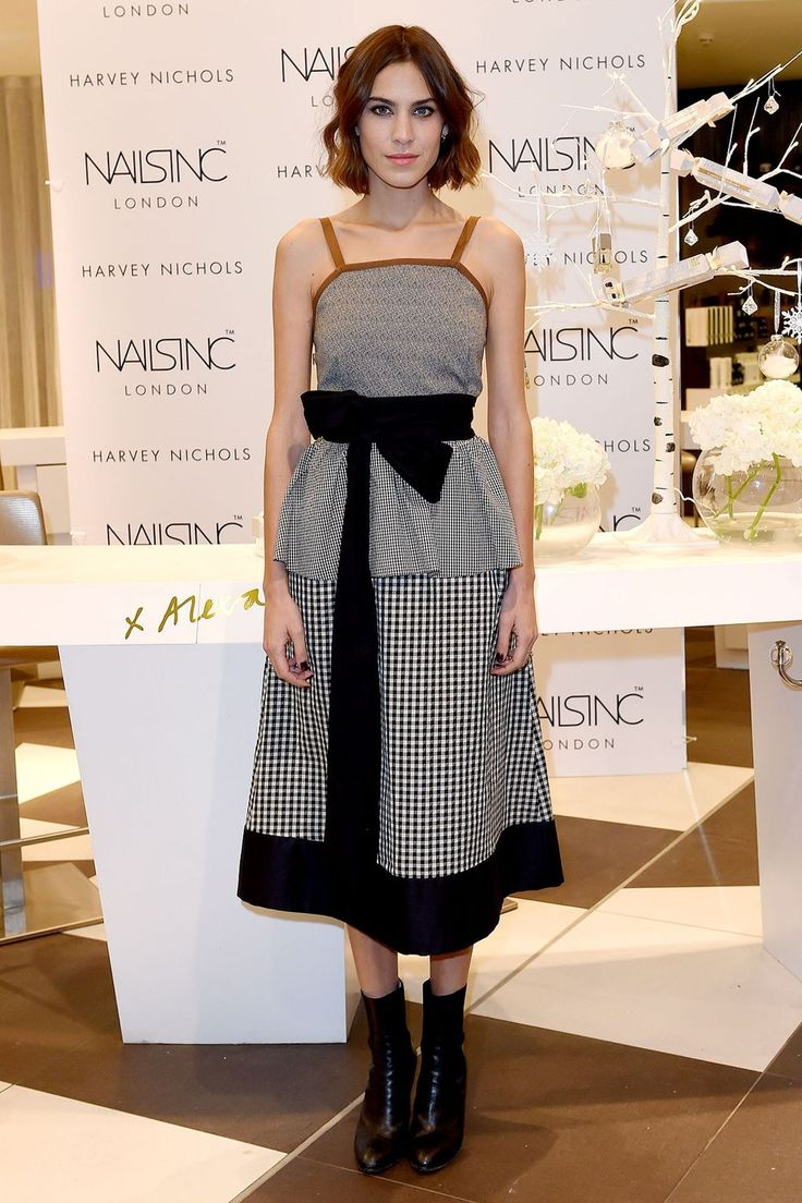 Appearing at Harvey Nichols in Liverpool, the ever-gorgeous star wore a checked monochrome dress complete with a waist-cinching bow, and finished off her look with black ankle boots.