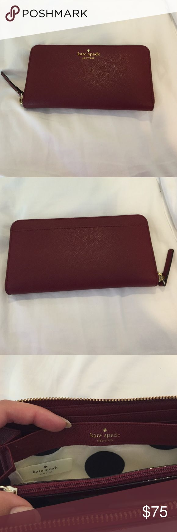 Kate Spade Cedar Street Lacy Wallet Color is a maroon color. It is in great condition. And goes with a lot more handbags than one would think. kate spade Bags Wallets