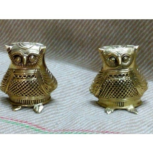 This exquisite pair of handcrafted Dokra artefact Owl is sure to leave your guests amazed. Adopt this Dokra Owl and add charm to your home decor.  Owl is not only considered the Vehicle or Mount of Goddess Laxmi..its considered a bird of wisdom considered a lucky charm in many countries .  Our artifacts are hand-crafted to perfection with detailed work by our Master-craftswomen. Made of finest quality of Dokra in antique finish.