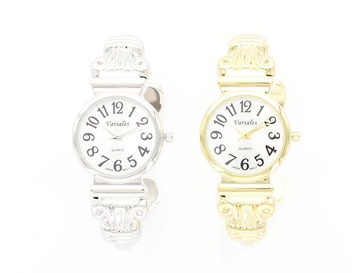 Ionic Column and Fleur de Lys Watch - The top of an Ionic Column sandwiches this round face watch, and ends in a fleur de lys relief at the opening.  Perfect and lightweight, to wear to the office, or pair with some sparkly bangles and bracelets for a more statement look! Available in Silver and Gold.