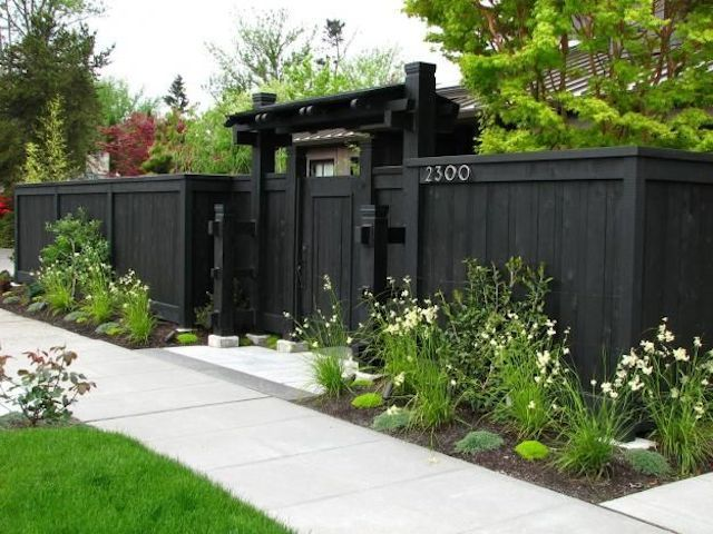 wooden privacy fence painted charcoal