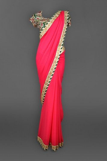 Featuring this beautiful Pink Georgette Sari with Choli Blouse in our wide range of Saris. Grab yourself one. Now!