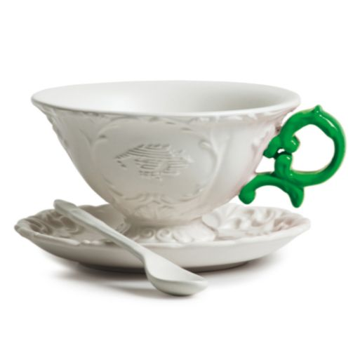 Seletti Large White & Green Baroque Style Teacup And Saucer Set: Baroque style, fine porcelain teacup, round saucer and spoon set. The ornate teacup has an porcelain pattern and a bold contrast green handle. A charming teacup and saucer set that would make a love gift. Set includes; cup, saucer and spoon. These designs are on permanent exhibition at MAD New York.