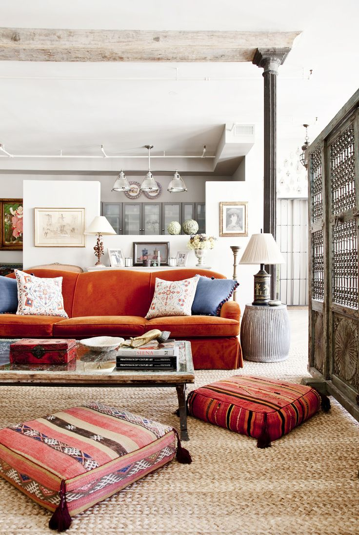 Rustic living room with orange sofa